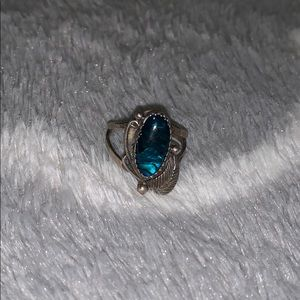 Silver ring with leaf accent, blue/green stone